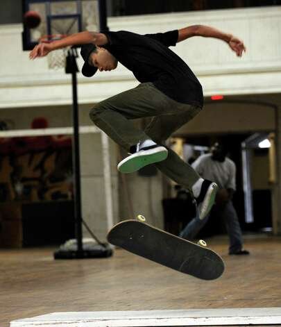 Caleb Candido, 19, of Danbury, does flips with his skateboard at the Harambee Center for Youth on West Street in Danbury Tuesday, Sept. 25, 2012. Photo: Carol Kaliff / The News-Times