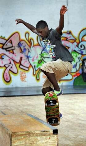 Shakii Watson, 13, of Danbury, skateboards at the Harambee Center for Youth in Danbury, Wed. Sept. 26, 2012. Photo: Carol Kaliff / The News-Times