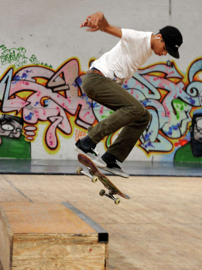 Caleb Candido, 19, of Danbury, skateboards at the Harambee Center for Youth on West Street in Danbury Tuesday, Sept. 25, 2012. Photo: Carol Kaliff