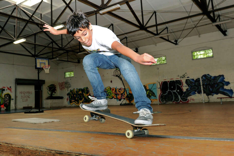 Leivin Placencia, 11, skateboards at the Harambee Center for Youth in Danbury, Wed. Sept. 26, 2012. Photo: Carol Kaliff