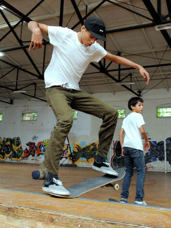 Caleb Candido, 19, of Danbury, skateboards at the Harambee Center for Youth on West Street in Danbury Tuesday, Sept. 25, 2012. Photo: Carol Kaliff / The News-Times