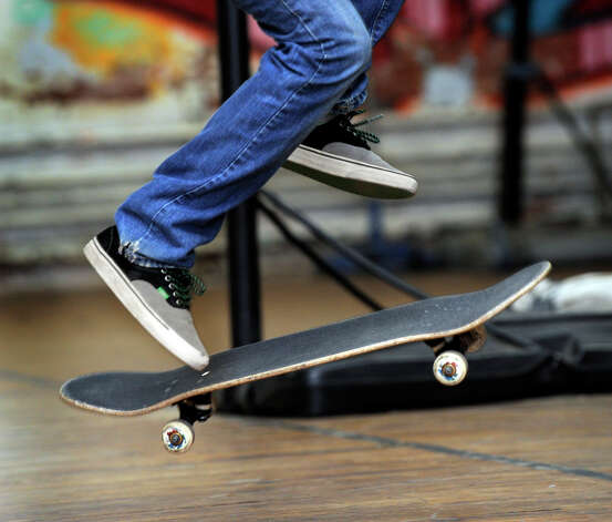 Caleb Candido, 19, of Danbury, does flips with his skateboard at the Harambee Center for Youth on West Street in Danbury Tuesday, Sept. 25, 2012. Photo: Carol Kaliff