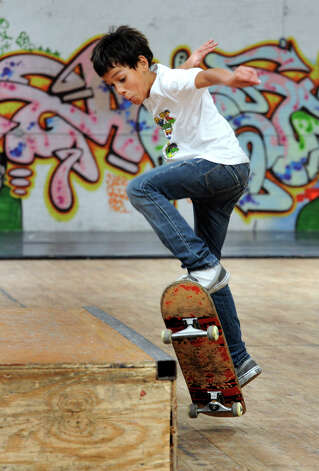 Leivin Placencia, 11, skateboards at the Harambee Center for Youth in Danbury, Wed. Sept. 26, 2012. Photo: Carol Kaliff / The News-Times