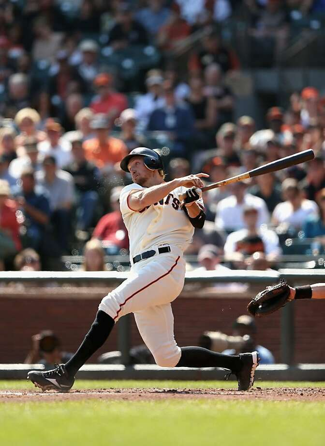 SAN FRANCISCO, CA - SEPTEMBER 27: Hunter Pence #8 of the San Francisco Giants hits a two run home run in the second inning against the Arizona Diamondbacks at AT&T Park on September 27, 2012 in San Francisco, California.  (Photo by Ezra Shaw/Getty Images) Photo: Ezra Shaw, Getty Images