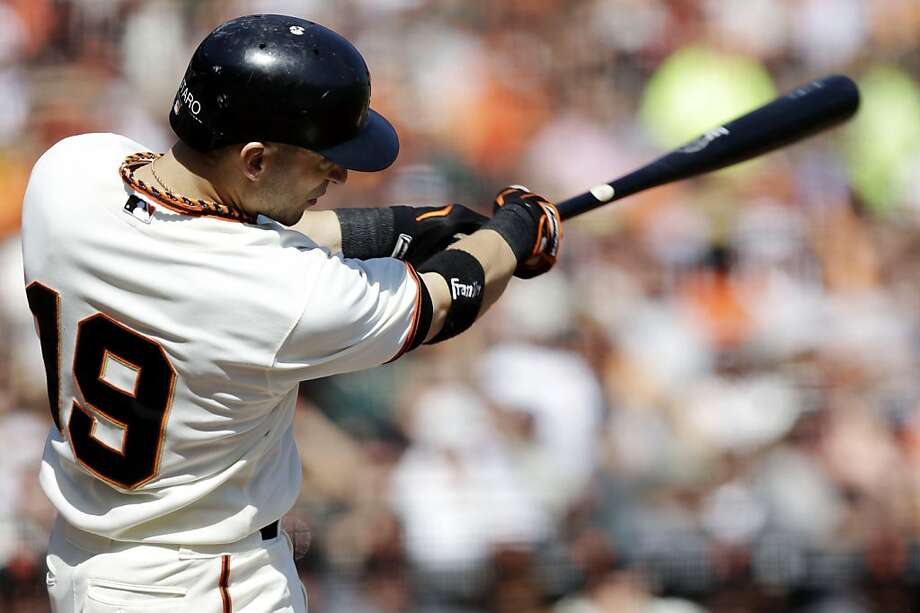 San Francisco Giants' Marco Scutaro hits a two-run home run against the Arizona Diamondbacks during the second inning of a baseball game, Thursday, Sept. 27, 2012, in San Francisco. (AP Photo/Marcio Jose Sanchez) Photo: Marcio Jose Sanchez, Associated Press