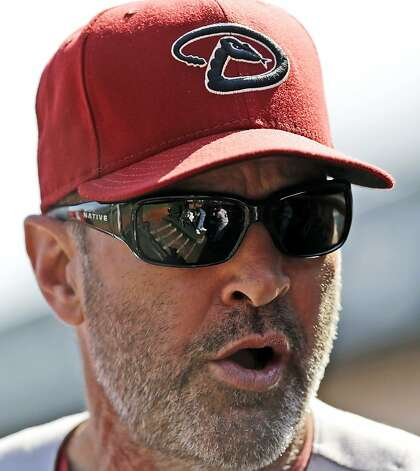 Arizona Diamondbacks manager Kirk Gibson speaks in the dugout as his team plays the San Francisco Giants during the first inning of a baseball game, Thursday, Sept. 27, 2012, in San Francisco. (AP Photo/Marcio Jose Sanchez) Photo: Marcio Jose Sanchez, Associated Press