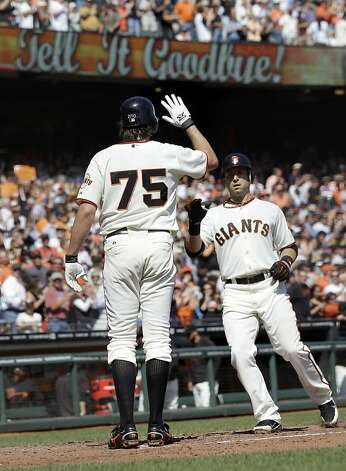 San Francisco Giants' Marco Scutaro, right, is met at the plate by Barry Zito (75) after Scutaro's two-run home run against the Arizona Diamondbacks during the second inning of a baseball game Thursday, Sept. 27, 2012, in San Francisco. (AP Photo/Marcio Jose Sanchez) Photo: Marcio Jose Sanchez, Associated Press