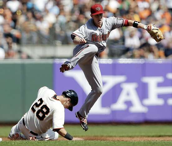 Arizona Diamondbacks second baseman Aaron Hill watches his throw to first after forcing out San Francisco Giants' Buster Posey on a ground ball by Hunter Pence during the third inning of a baseball game Thursday, Sept. 27, 2012, in San Francisco. Pence was out at first. (AP Photo/Marcio Jose Sanchez) Photo: Marcio Jose Sanchez, Associated Press