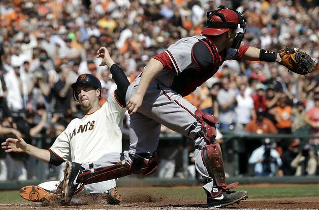 San Francisco Giants' Brandon Belt, left, scores on a double by Hector Sanchez as Arizona Diamondbacks catcher Miguel Montero, right, waits for the throw during the second inning of a baseball game, Thursday, Sept. 27, 2012, in San Francisco. (AP Photo/Marcio Jose Sanchez) Photo: Marcio Jose Sanchez, Associated Press