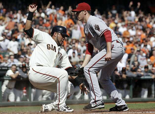 San Francisco Giants' Hector Sanchez, left, scores next to Arizona Diamondbacks starting pitcher Patrick Corbin on a passed ball by catcher Miguel Montero during the second inning of a baseball game, Thursday, Sept. 27, 2012, in San Francisco. (AP Photo/Marcio Jose Sanchez) Photo: Marcio Jose Sanchez, Associated Press