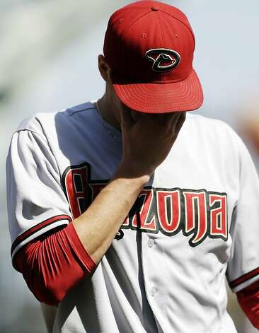 Arizona Diamondbacks starting pitcher Patrick Corbin walks back to the dugout at the end of a six-run second inning by the San Francisco Giants during a baseball game, Thursday, Sept. 27, 2012, in San Francisco. (AP Photo/Marcio Jose Sanchez) Photo: Marcio Jose Sanchez, Associated Press