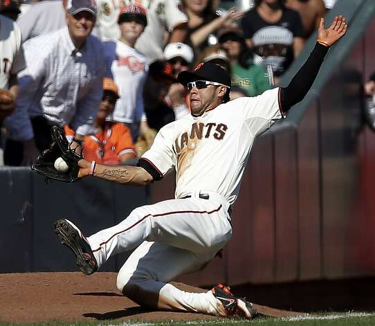 San Francisco Giants left fielder Gregor Blanco makes a sliding catch on a pop fly from Arizona Diamondbacks' Adam Eaton during the ninth inning of a baseball game, Thursday, Sept. 27, 2012, in San Francisco. San Francisco won 7-3. (AP Photo/Marcio Jose Sanchez) Photo: Marcio Jose Sanchez, Associated Press
