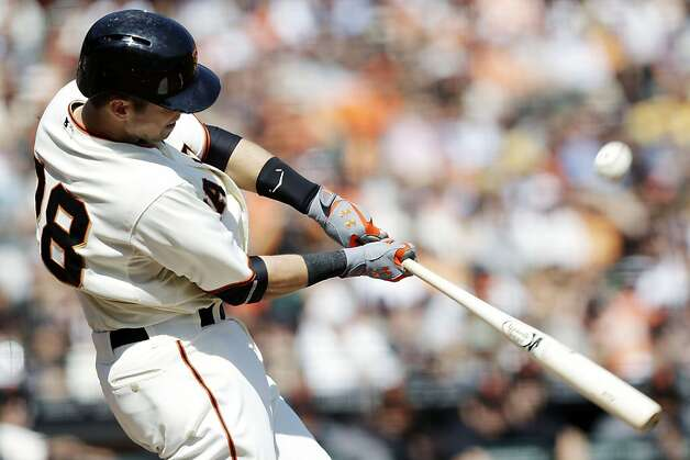 San Francisco Giants' Buster Posey singles against the Arizona Diamondbacks during the third inning of a baseball game, Thursday, Sept. 27, 2012, in San Francisco. (AP Photo/Marcio Jose Sanchez) Photo: Marcio Jose Sanchez, Associated Press
