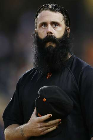 FILE - In this Sept. 25, 2012, file photo, San Francisco Giants relief pitcher Brian Wilson looks on from the dugout during a baseball game against the Arizona Diamondbacks in San Francisco. Wilson is scheduled to throw Oct. 19 for the first time since Tommy John surgery, and the always-confident closer insists he will be full strength by next year. (AP Photo/Marcio Jose Sanchez, File) Photo: Marcio Jose Sanchez, Associated Press