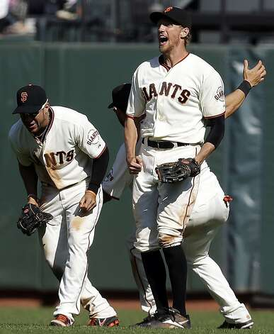 From left, San Francisco Giants' Gregor Blanco, Angel Pagan and Hunter Pence celebrate their 7-3 win over the Arizona Diamondbacks during a baseball game, Thursday, Sept. 27, 2012, in San Francisco. (AP Photo/Marcio Jose Sanchez) Photo: Marcio Jose Sanchez, Associated Press