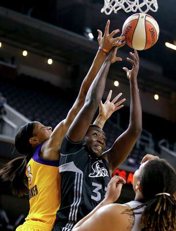 San Antonio Silver Stars' Sophia Young, center, and Los Angeles Sparks' Candace Parker reach for a rebound during Game 1 of a WNBA basketball first-round playoff series, in Los Angeles on Thursday, Sept. 27, 2012. (AP Photo/Jae C. Hong) Photo: Jae C. Hong, Associated Press / AP