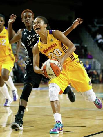 Los Angeles Sparks' Kristi Toliver, center, drives to the basket past San Antonio Silver Stars' Danielle Robinson during Game 1 of a WNBA basketball first-round playoff series, in Los Angeles on Thursday, Sept. 27, 2012. (AP Photo/Jae C. Hong) Photo: Jae C. Hong, Associated Press / AP