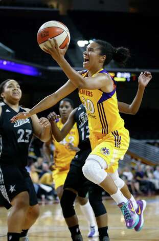 Los Angeles Sparks' Kristi Toliver goes up for a shot as San Antonio Silver Stars' Danielle Adams, background left, watches during Game 1 of a WNBA basketball first-round playoff series, in Los Angeles on Thursday, Sept. 27, 2012. (AP Photo/Jae C. Hong) Photo: Jae C. Hong, Associated Press / AP