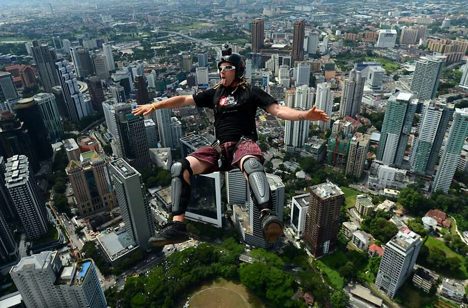 Adrenaline junkie:Base jumper Paul Morton of New Zealand jumps backward off the 421-meter (1,381-foot) Kuala Lumpur Tower during the four-day International Tower Jump. He has only seconds to open his parachute before he lands. Photo: Mohd Rasfan, AFP/Getty Images