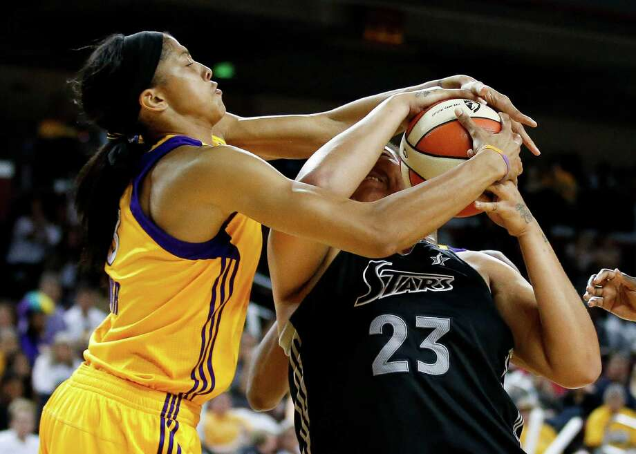 San Antonio Silver Stars' Danielle Adams, right, is defended by Los Angeles Sparks' Candace Parker during game 1 of a WNBA Western Conference Semifinal in Los Angeles, Thursday, Sept. 27, 2012. The Sparks won 93-86. (AP Photo/Jae C. Hong) Photo: Jae C. Hong, Associated Press / AP