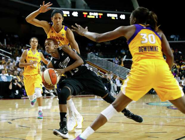 San Antonio Silver Stars' Danielle Robinson(13) is defended by Los Angeles Sparks' Nneka Ogwumike(30) and Candace Parker during game 1 of a WNBA Western Conference Semifinal in Los Angeles, Thursday, Sept. 27, 2012. The Sparks won 93-86. (AP Photo/Jae C. Hong) Photo: Jae C. Hong, Associated Press / AP