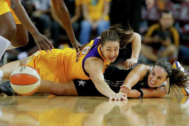 San Antonio Silver Stars' Becky Hammon, right, and Los Angeles Sparks' Jenna O'Hea look at a loose ball during game 1 of a WNBA Western Conference Semifinal in Los Angeles, Thursday, Sept. 27, 2012. The Sparks won 93-86. (AP Photo/Jae C. Hong) Photo: Jae C. Hong, Associated Press / AP