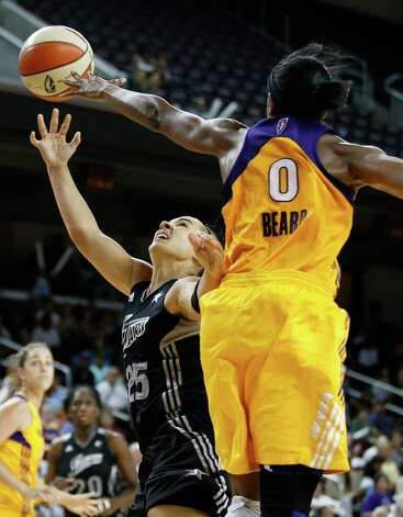 San Antonio Silver Stars' Becky Hammon, left, gets her shot blocked by Los Angeles Sparks' Alana Beard during game 1 of a WNBA Western Conference Semifinal in Los Angeles, Thursday, Sept. 27, 2012. The Sparks won 93-86. (AP Photo/Jae C. Hong) Photo: Jae C. Hong, Associated Press / AP