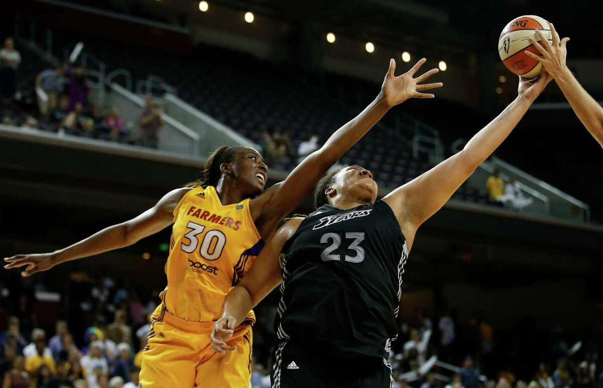 San Antonio Silver Stars' Danielle Adams, right, and Los Angeles Sparks' Nneka Ogwumike reach for a rebound during game 1 of a WNBA Western Conference Semifinal in Los Angeles, Thursday, Sept. 27, 2012. The Sparks won 93-86. (AP Photo/Jae C. Hong)