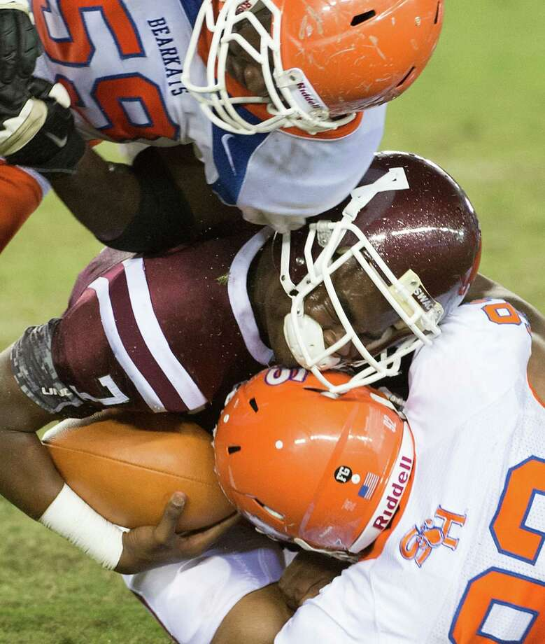 Texas Southern quarterback Justice Jones (7) is dropped for a loss by Sam Houston State defensive lineman J.T. Cleveland (59) and Sam Houston State linebacker Mouf Adebo (92) during the first quarter. Photo: Smiley N. Pool, Houston Chronicle / © 2012  Houston Chronicle