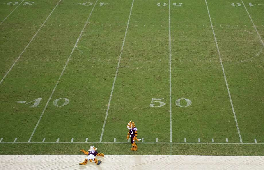 "The Texas Southern University mascots perform on an empty field during halftime. TSU suspended its renowned ""Ocean of Soul"" marching band as officials investigate alleged hazing, canceling Thursday's scheduled band performance during the game. Photo: Smiley N. Pool, Houston Chronicle / © 2012  Houston Chronicle"