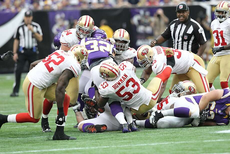 DS2_3416.JPG MINNEAPOLIS, MN - SEPTEMBER 23:  San Francisco 49ers inside linebacker NaVorro Bowman (53) tackles Minnesota Vikings running back Toby Gerhart (32) in the fourth quarter during the NFL game at Mall of America Field at the Hubert H. Humphrey Metrodome on September 23, 2012 in Minneapolis, Minnesota.  Photo by David Sherman/Special to the Chronicle. Photo: David Sherman, SFC