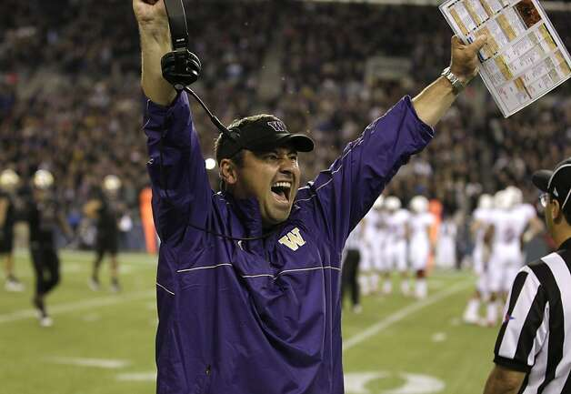 Washington head coach Steve Sarkisian celebrates a play late in an NCAA college football game against Stanford, Thursday, Sept. 27, 2012, in Seattle. Washington beat Stanford, 17-13. (AP Photo/Ted S. Warren) Photo: Ted S. Warren, Associated Press