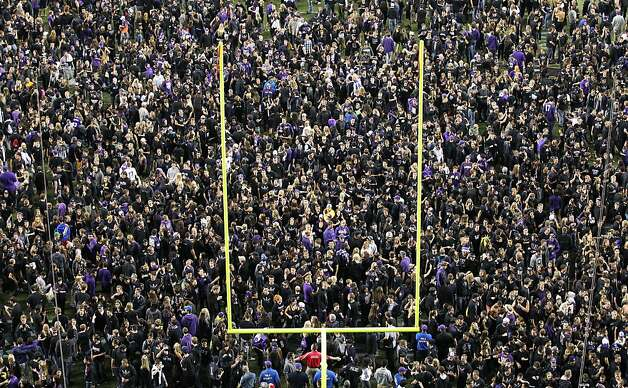 Washington fans soak up the victory vibes after the Huskies overcame a 13-3 deficit late in the third quarter to upend No. 8 Stanford. Photo: Otto Greule Jr, Getty Images