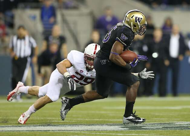 Bishop Sankey eludes Stanford's Ed Reynolds on the way to a 61-yard score to end the third quarter. Photo: Otto Greule Jr, Getty Images