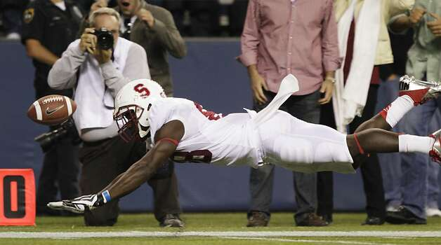 Stanford's Ty Montgomery can't catch a pass in the second half of an NCAA college football game against Washington, Thursday, Sept. 27, 2012, in Seattle. Washington beat Stanford, 17-13. (AP Photo/Ted S. Warren) Photo: Ted S. Warren, Associated Press