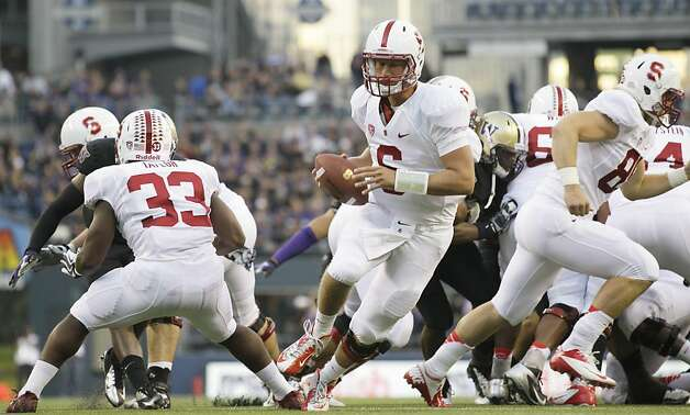 Stanford quarterback Josh Nunes, center, drops to pass against Washington in the first half of an NCAA college football game, Thursday, Sept. 27, 2012, in Seattle. Washington beat Stanford, 17-13. (AP Photo/Ted S. Warren) Photo: Ted S. Warren, Associated Press