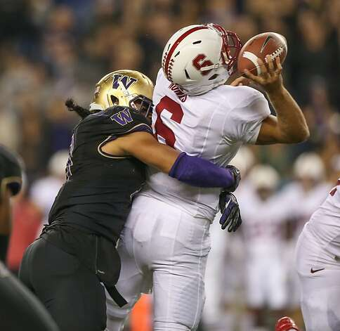 SEATTLE, WA - SEPTEMBER 27:  Linebacker John Timu #10 of the Washington Huskies sacks quarterback Josh Nunes #6 of the Stanford Cardinal on September 27, 2012 at CenturyLink Field in Seattle, Washington. Washington defeated Stanford 17-13.  (Photo by Otto Greule Jr/Getty Images) Photo: Otto Greule Jr, Getty Images