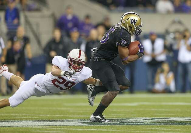 SEATTLE, WA - SEPTEMBER 27:  Running back Bishop Sankey #25 of the Washington Huskies rushes for a 61 yard touchdown past safety Ed Reynolds #29 of the Stanford Cardinal on September 27, 2012 at CenturyLink Field in Seattle, Washington. Washington defeated Stanford 17-13.  (Photo by Otto Greule Jr/Getty Images) Photo: Otto Greule Jr, Getty Images