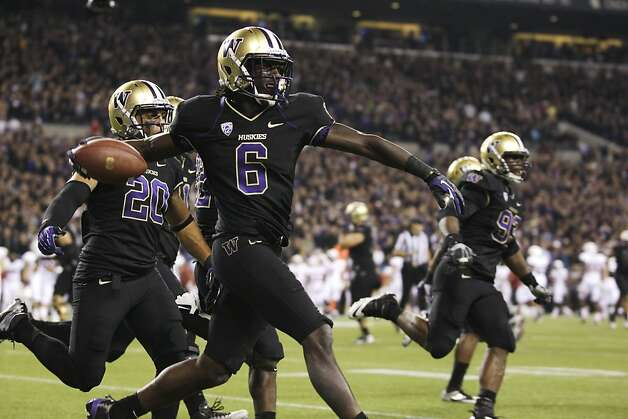 Washington's Desmond Trufant celebrates his interception against Stanford play late in the second half of an NCAA college football game against Stanford, Thursday, Sept. 27, 2012, in Seattle. Washington beat Stanford, 17-13. (AP Photo/Ted S. Warren) Photo: Ted S. Warren, Associated Press
