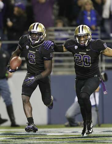 Washington's Desmond Trufant, left, celebrates his interception against Stanford with Justin Glenn (20) in the second half of an NCAA college football game against Stanford, Thursday, Sept. 27, 2012, in Seattle. Washington beat Stanford, 17-13. (AP Photo/Ted S. Warren) Photo: Ted S. Warren, Associated Press