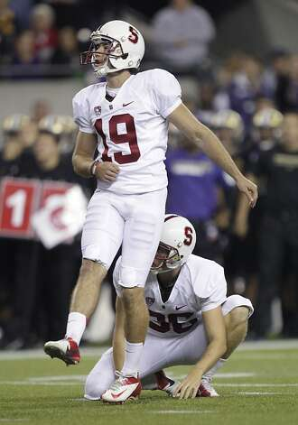 Stanford's Jordan Williamson (19) watches with holder Daniel Zychlinski after Williamson kicked a field goal against Washington in the first half of an NCAA college football game, Thursday, Sept. 27, 2012, in Seattle. (AP Photo/Ted S. Warren) Photo: Ted S. Warren, Associated Press