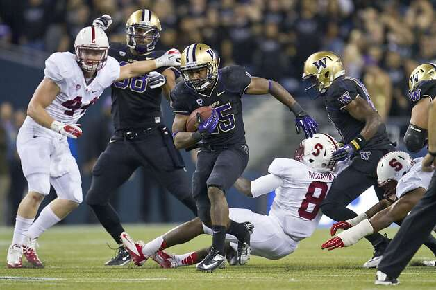 Washington's Bishop Sankey gets past Stanford defenders on a 61-yard touchdown during the third quarter of an NCAA college football game Thursday, Sept. 27, 2012, in Seattle. (AP Photo/The Seattle Times, Dean Rutz) SEATTLE OUT, USA TODAY OUT, MAGS OUT  NO SALES  TV OUT   MANDATORY CREDIT Photo: Dean Rutz, Associated Press