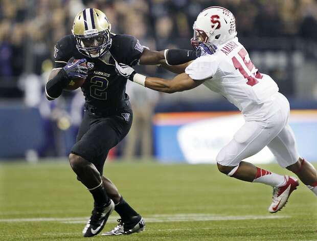 Washington's Kasen Williams (2) tries to fend off  Stanford's Usua Amanam, right, during the first half of an NCAA college football game, Thursday, Sept. 27, 2012, in Seattle. (AP Photo/Ted S. Warren) Photo: Ted S. Warren, Associated Press