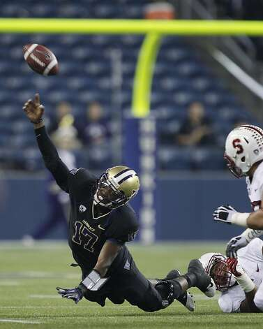 Washington quarterback Keith Price gets rid of the ball as he goes down in the first half of an NCAA college football game against Stanford, Thursday, Sept. 27, 2012, in Seattle. Price was flagged for intentional grounding. (AP Photo/Ted S. Warren) Photo: Ted S. Warren, Associated Press