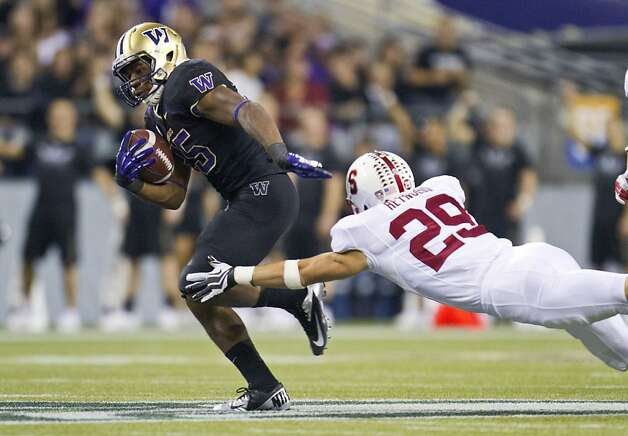 Washington's Bishop Sankey gets away from Stanford's Ed Reynolds on a 61-yard touchdown during the third quarter of an NCAA college football game Thursday, Sept. 27, 2012, in Seattle. (AP Photo/The Seattle Times, Dean Rutz) SEATTLE OUT, USA TODAY OUT, MAGS OUT  NO SALES  TV OUT   MANDATORY CREDIT Photo: Dean Rutz, Associated Press