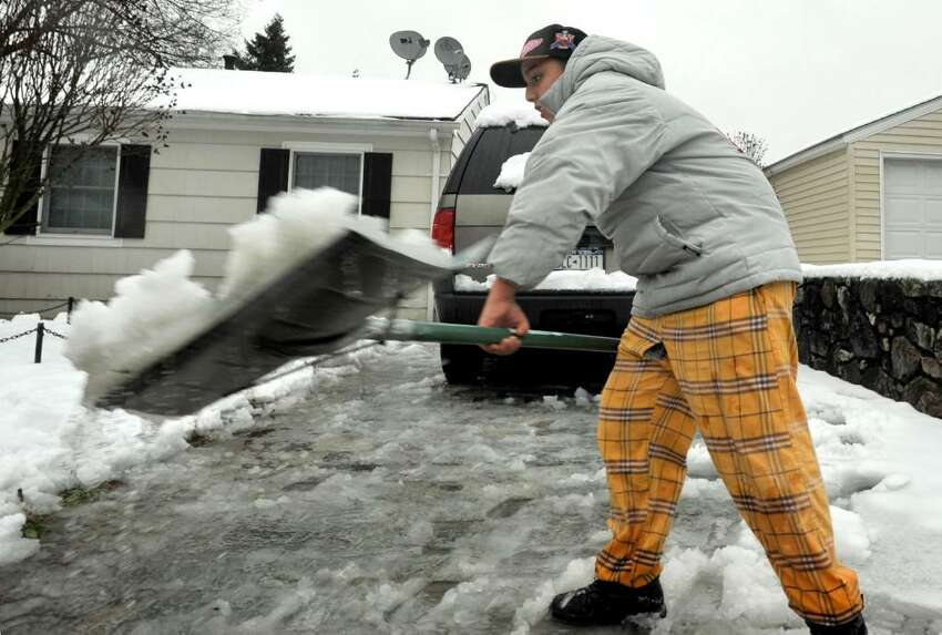Christian Villo, 15, shovels wet snow from the driveway of his Danbury home on Wendesday, Dec.9, 2009.