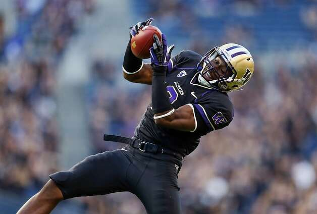 SEATTLE, WA - SEPTEMBER 27:  Wide receiver Kasen Williams #2 of the Washington Huskies makes a leaping catch against the Stanford Cardinal on September 27, 2012 at CenturyLink Field in Seattle, Washington. Washington defeated Stanford 17-13.  (Photo by Otto Greule Jr/Getty Images) Photo: Otto Greule Jr, Getty Images