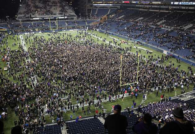 SEATTLE, WA - SEPTEMBER 27:  Husky fans storm the field after defeating the Stanford Cardinal 17-13 on September 27, 2012 at CenturyLink Field in Seattle, Washington.  (Photo by Otto Greule Jr/Getty Images) Photo: Otto Greule Jr, Getty Images