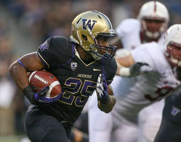 SEATTLE, WA - SEPTEMBER 27:  Running back Bishop Sankey #25 of the Washington Huskies rushes against the Stanford Cardinal on September 27, 2012 at CenturyLink Field in Seattle, Washington. Washington defeated Stanford 17-13.  (Photo by Otto Greule Jr/Getty Images) Photo: Otto Greule Jr, Getty Images