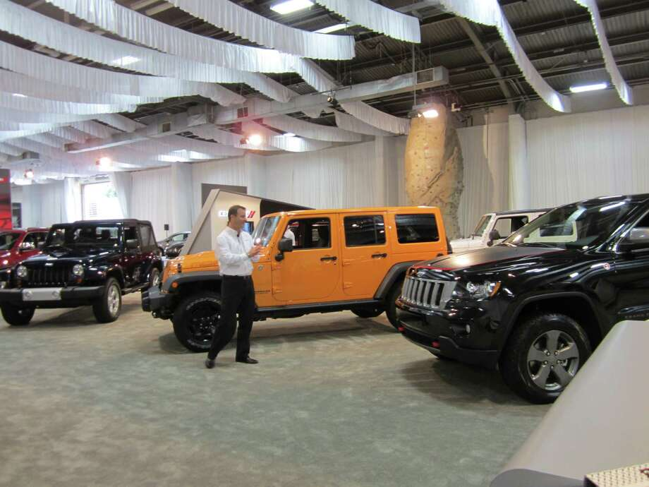 Cars and trucks aplently are on display at the State Fair of Texas auto show in Dallas on Thursday, Sept. 27, 2012. Photo: Neal Morton, San Antonio Express-News